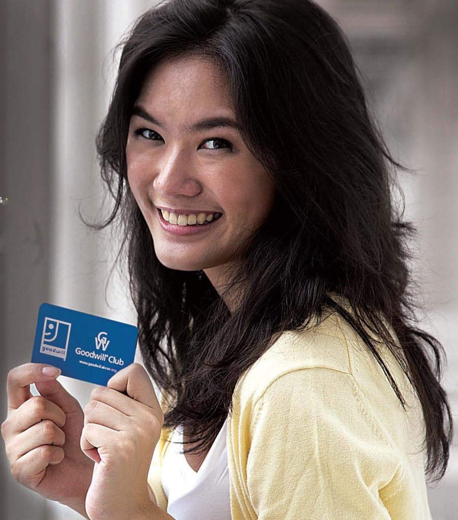 woman holding Goodwill Club card image