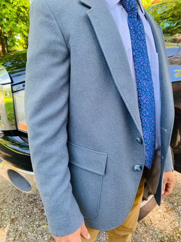 close up of suit worn by young man